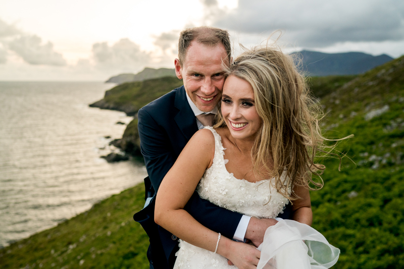 Bride and groom on Muckross Head, Kilcar with Sliabh Liag in the background as the sunsets. Photo by Paul McGinty, Ghorm Studio Photography