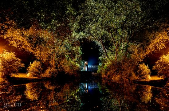 the bride and groom on lovers bridge at night. The took a break from dancing for this shot in Harvey's Point, Lough, Co Donegal, Ireland. Photo by award winning photographer, Paul McGinty from Ghorm Studio Photography.