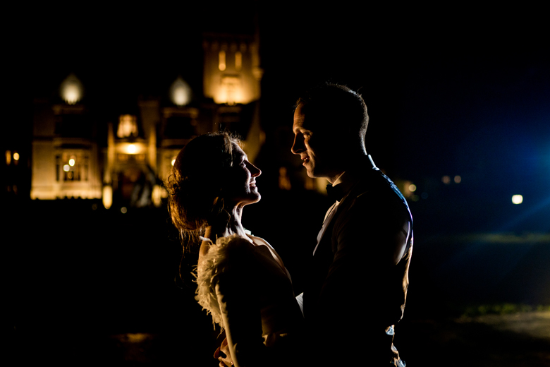 Bride and groom outside Lough Eske Castle on an Autumn night, one of irelands best wedding venues. Photo by Paul McGinty from Ghorm Studio Photography