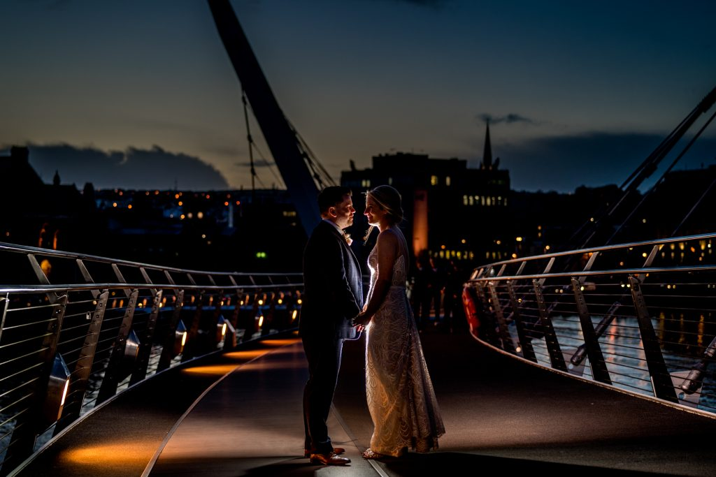 Derry city wedding, bride and groom on the Peace Bridge in october 2020. Photo by Paul McGinty, Ghorm Studio Photography, Lough Eske, Donegal Town.