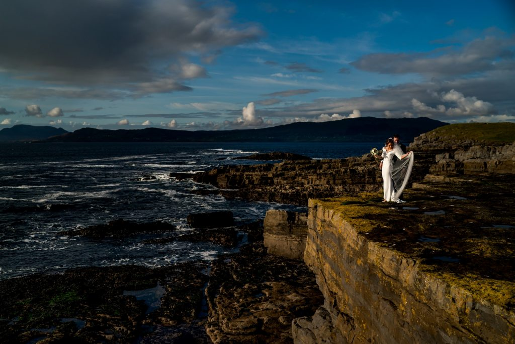 bride and groom on sea cliffs Lough Eske castle wedding, Autumn 2019, best wedding venue, photo by Paul McGinty from Ghorm studio photography, Donegal Town, Ireland