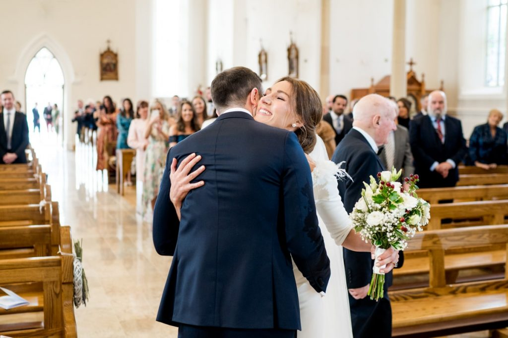 bride hugging groom, Lough Eske castle wedding, Autumn 2019, best wedding venue, photo by Paul McGinty from Ghorm studio photography, Donegal Town, Ireland