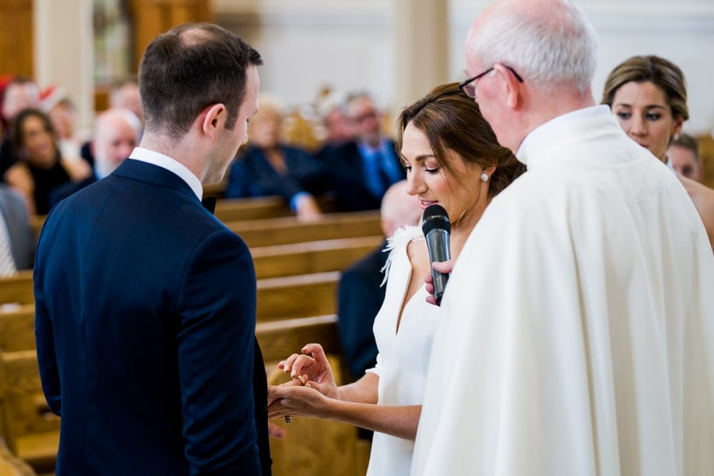 exchange of rings, Lough Eske castle wedding, Autumn 2019, best wedding venue, photo by Paul McGinty from Ghorm studio photography, Donegal Town, Ireland