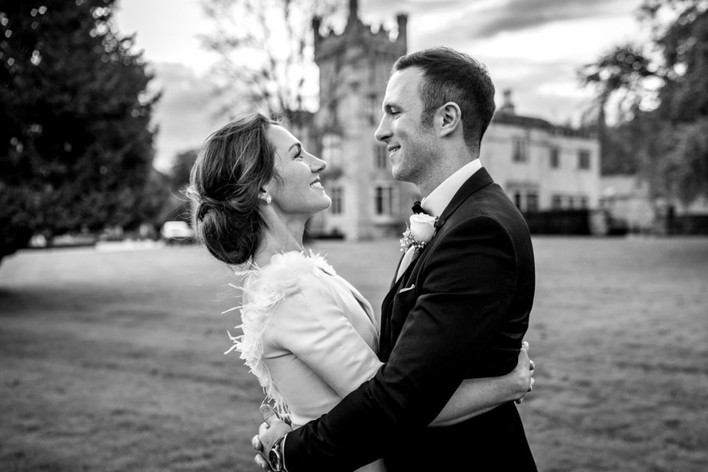 bride hugging the groom, Lough Eske castle wedding, Autumn 2019, best wedding venue, photo by Paul McGinty from Ghorm studio photography, Donegal Town, Ireland