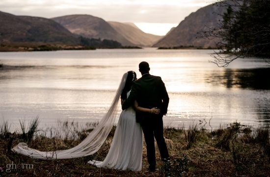 Bride and groom in Glenveagh National Park, their intimate cover 19 wedding in winter with a sunset , Covid wedding in Letterkenny, Co Donegal. Photo by Paul McGinty from Ghorm Studio Photography, Lough Eske, Donegal Town.