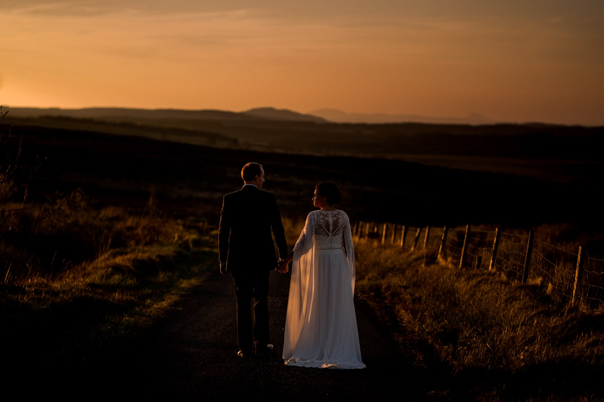 Bride and groom in the middle of a bog on the Tyrone donegal border, Northern Ireland as the sun was setting on their intimate covid 19 wedding. intimate wedding photographer, elopement Ireland, Donegal Sligo, Leitrim Wedding Photographer, Paul McGinty, Ghorm Studio Photography, Lough Eske Donegal Town.