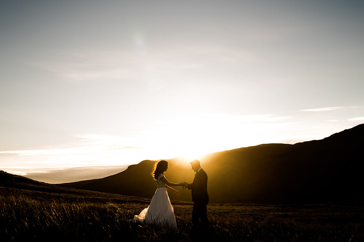 bride and groom dancing in the Bluestack mountains as the sunsets over the hills of donegal. Irish castle wedding, Lough Eske wedding, Paul McGinty, Ghorm Studio Photography