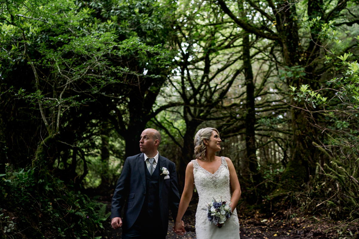 Niamh and Ian in a forest near Lough Eske Castle and Harvey's Point hotel outside donegal Town. Photo by Paul Mcginty Ghorm Studio Photography