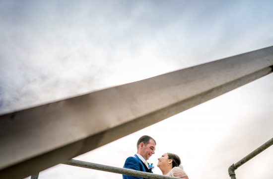 bride nd groom on mountcharles pier in Donegal bay, marquee wedding, Paul McGinty photographer Ghorm studio.