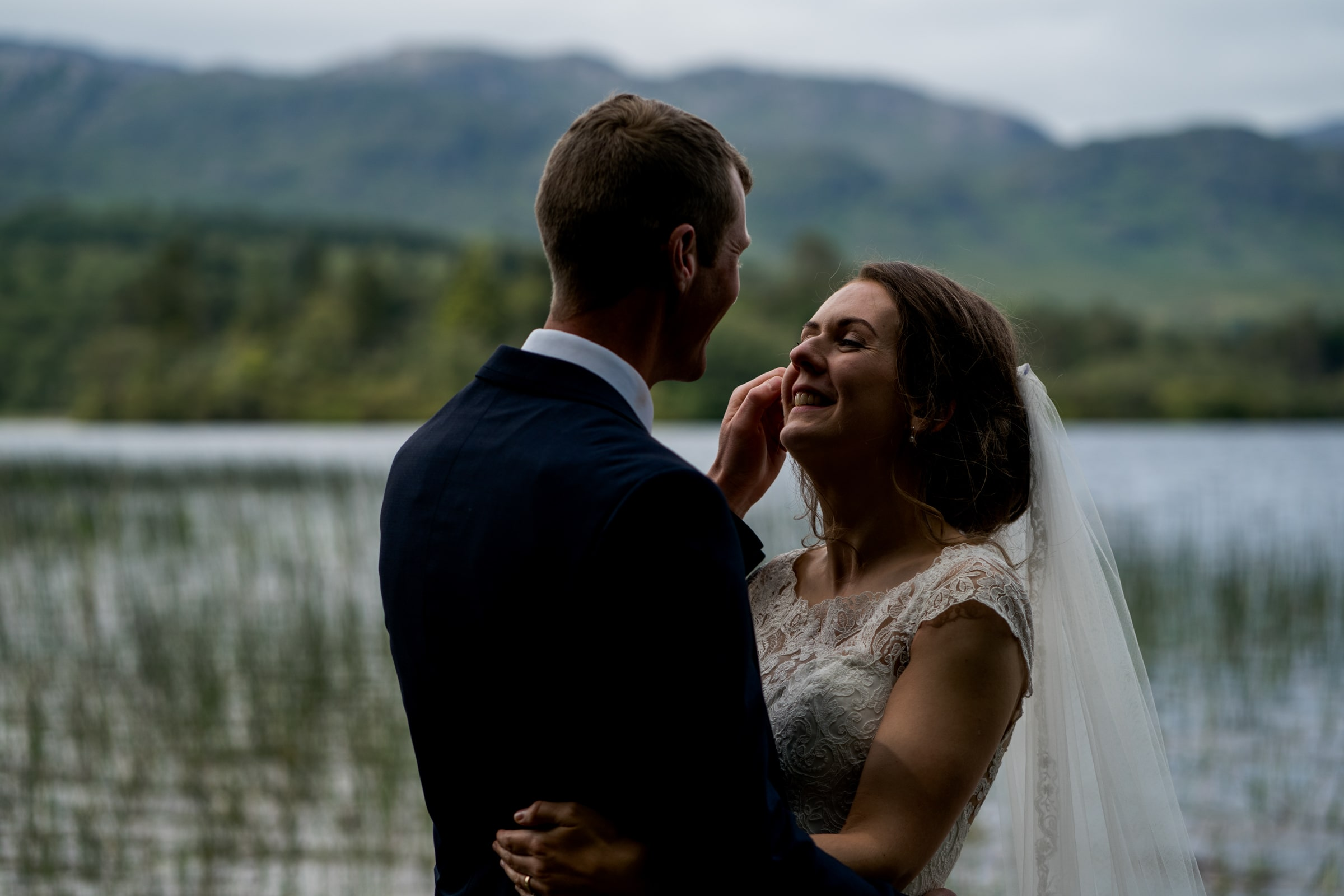 Bride and groom on the shores of Lough Eske on their wedding day in Donegal Town