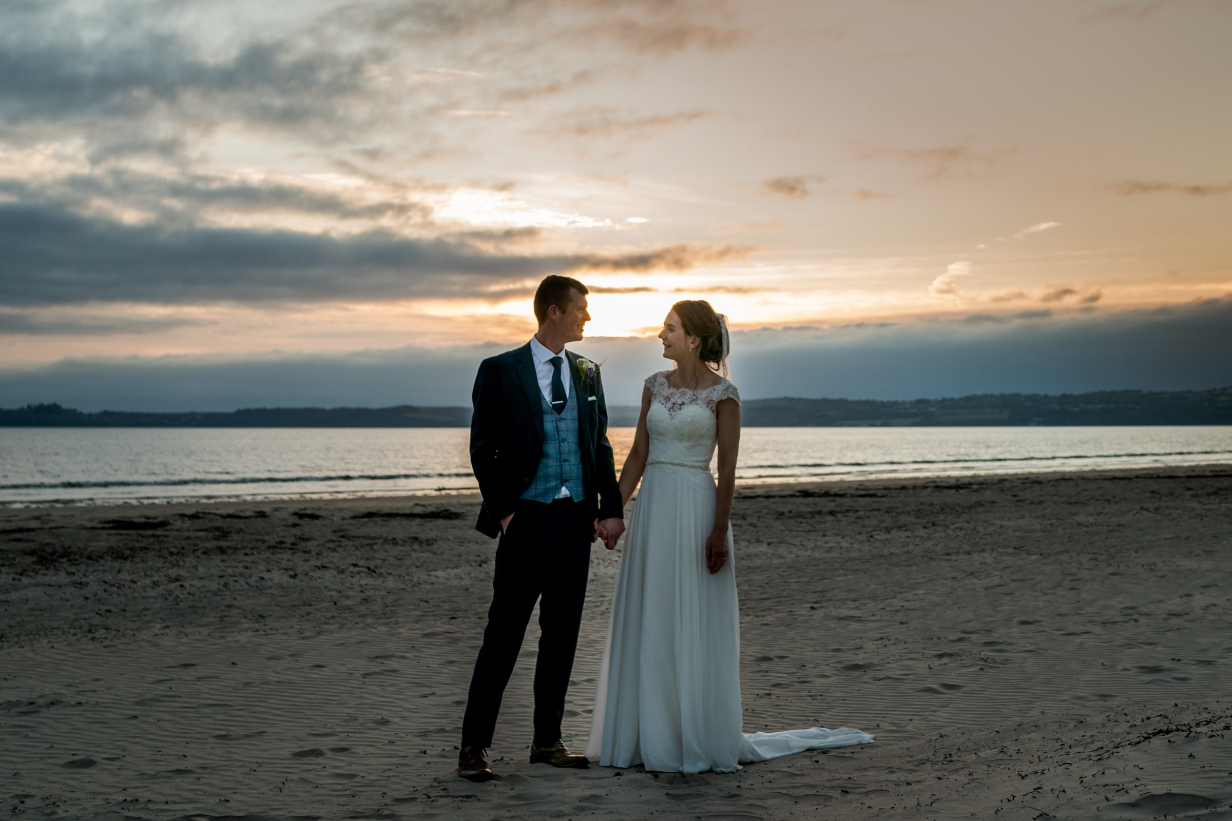 wedding photographer Donegal bride and groom on a beach at sunset.