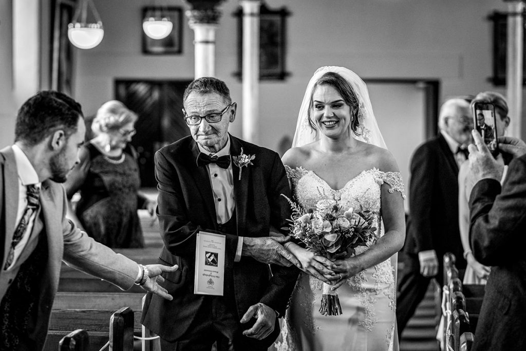 bride and father walking down the aisle, Marquee wedding in Annagry, Co Donegal Ireland, Photo by Paul McGinty, Ghorm Studio Photography.