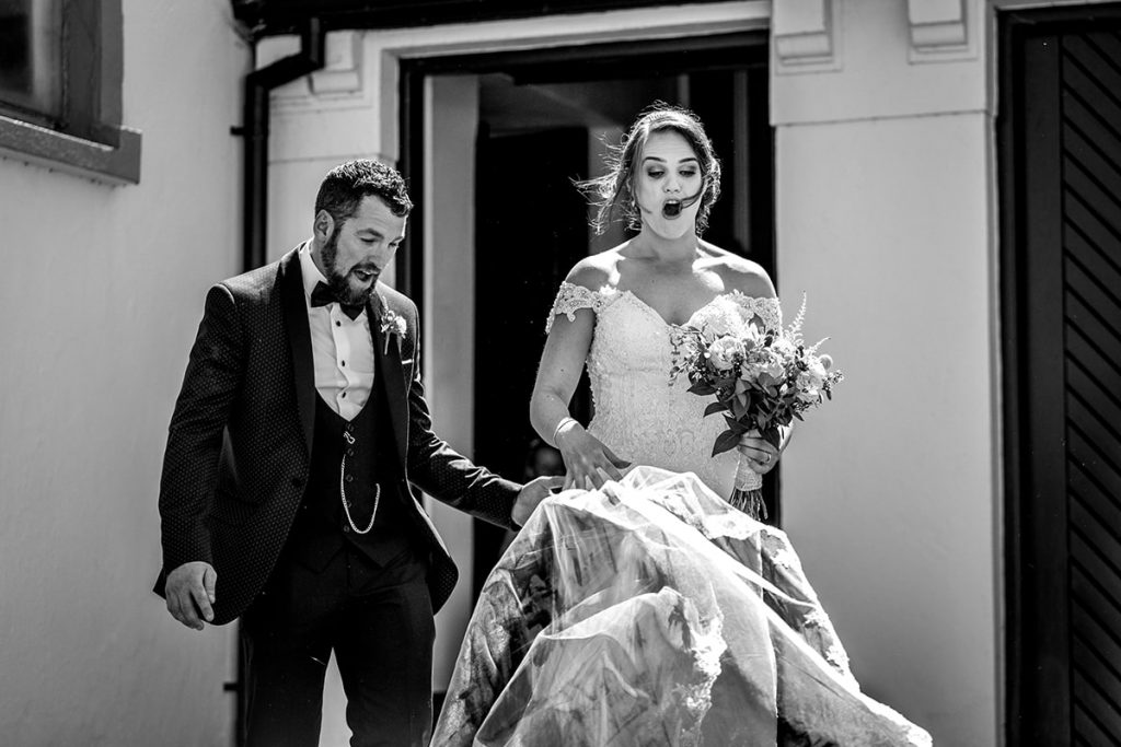 bride view blows off her head, Marquee wedding in Annagry, Co Donegal Ireland, Photo by Paul McGinty, Ghorm Studio Photography.