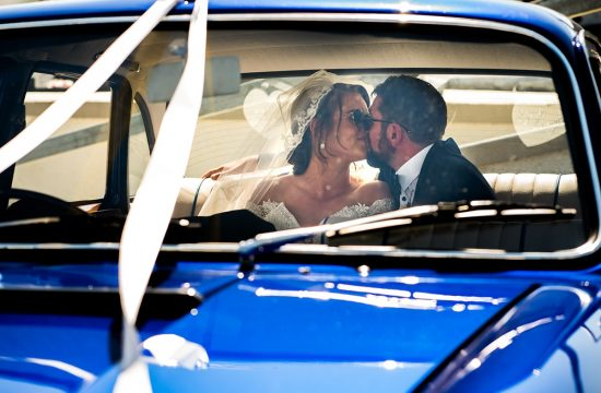 bride and groom kissing in vintage wedding car, Marquee wedding in Annagry, Co Donegal Ireland, Photo by Paul McGinty, Ghorm Studio Photography.