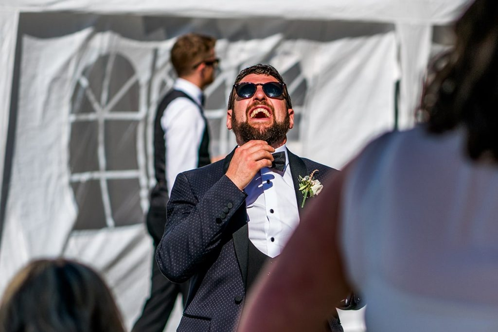 groom laughing, Marquee wedding in Annagry, Co Donegal Ireland, Photo by Paul McGinty, Ghorm Studio Photography.