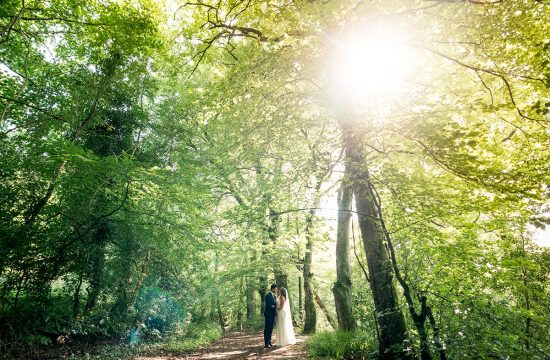 Bride and groom in a forest with the sun shinning in Letterkenny, Co Donegal Ireland, Silver Tassie Wedding by Paul McGinty Photography, Ghorm Studio Photography
