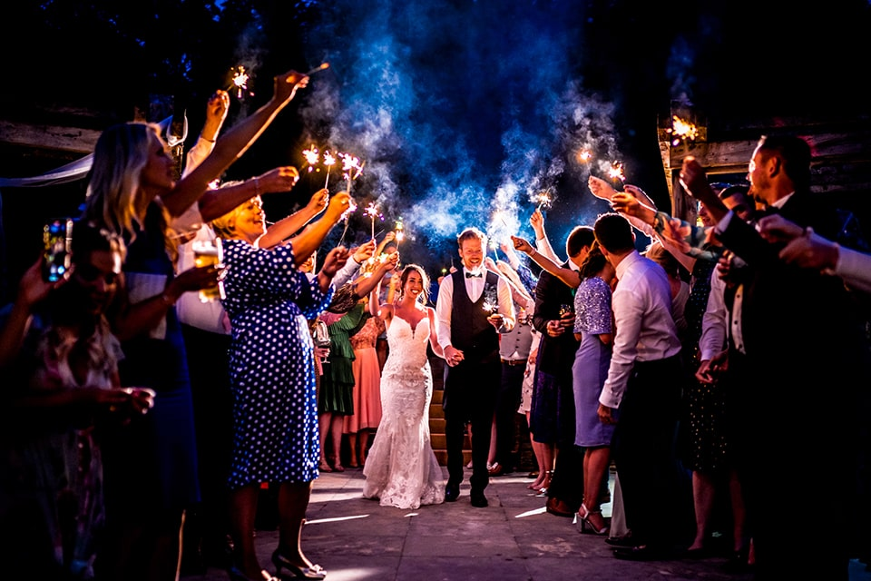bride and groom with a sparklers shoe at night outside, irish castle wedding eleopement Lough Eske wedding Photographer, Paul Mcginty, Ghorm Studio Photography