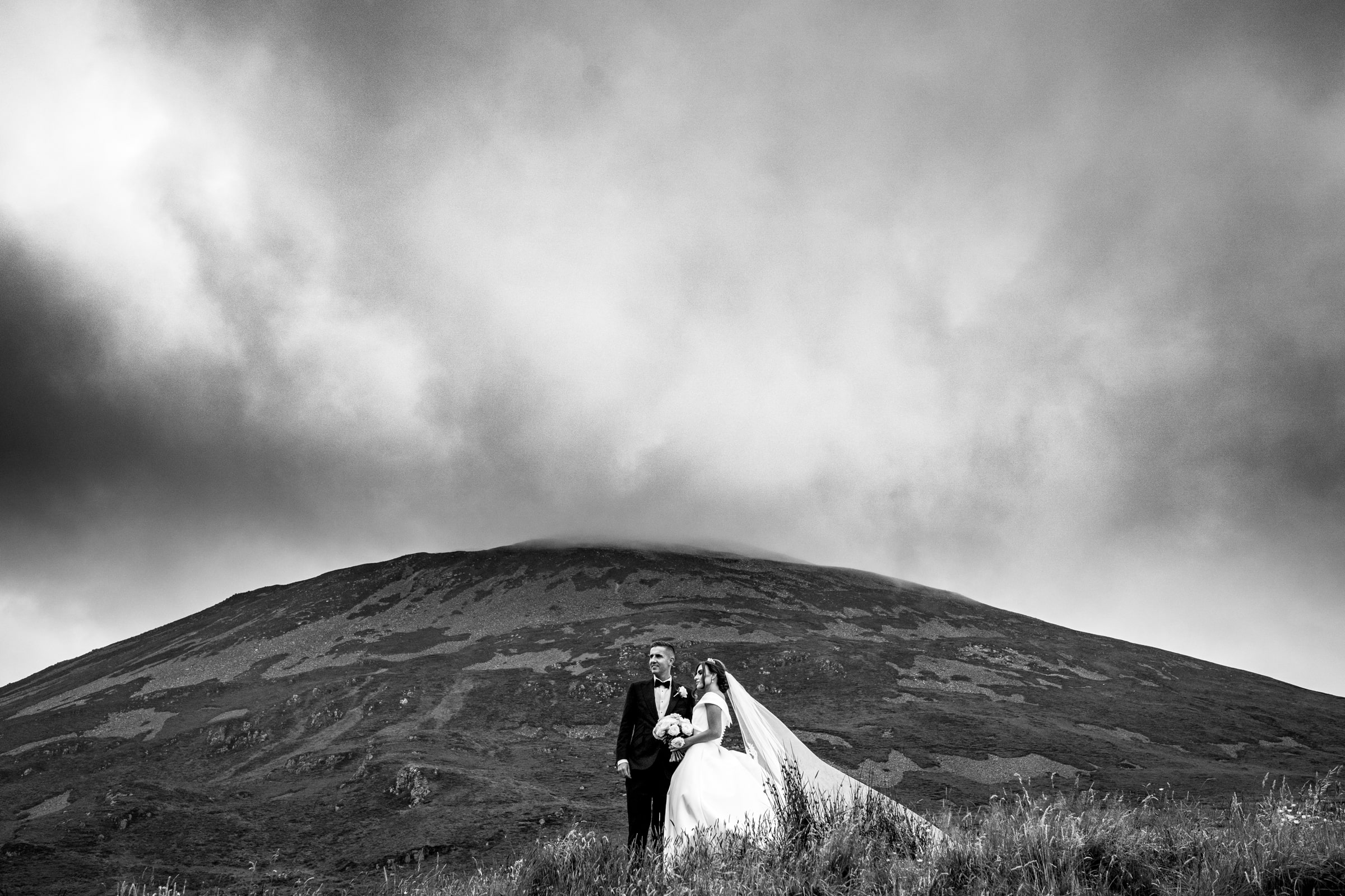 silver Tassie hotel wedding, donegal wedding venue, photographer donegal, bride and groom in the Poisoned Glen with Mount Errigal in the background, photo by Paul McGinty from Ghorm Studio photography Lough Eske.