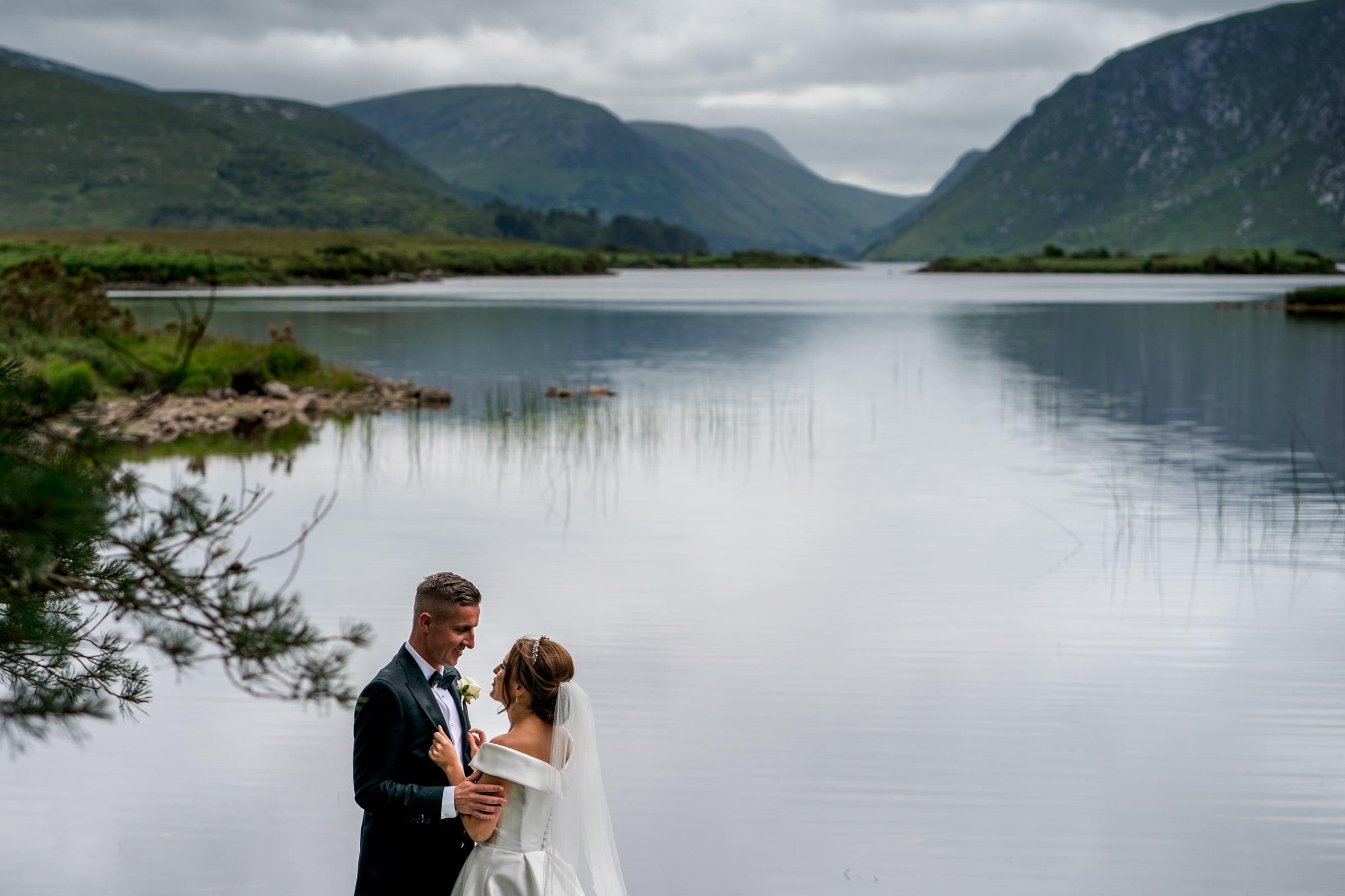 bride and groom in Glen weigh National Park, silver Tassie hotel wedding, donegal wedding venue, photographer donegal, bride and groom in the Poisoned Glen with Mount Errigal in the background, photo by Paul McGinty from Ghorm Studio photography Lough Eske.